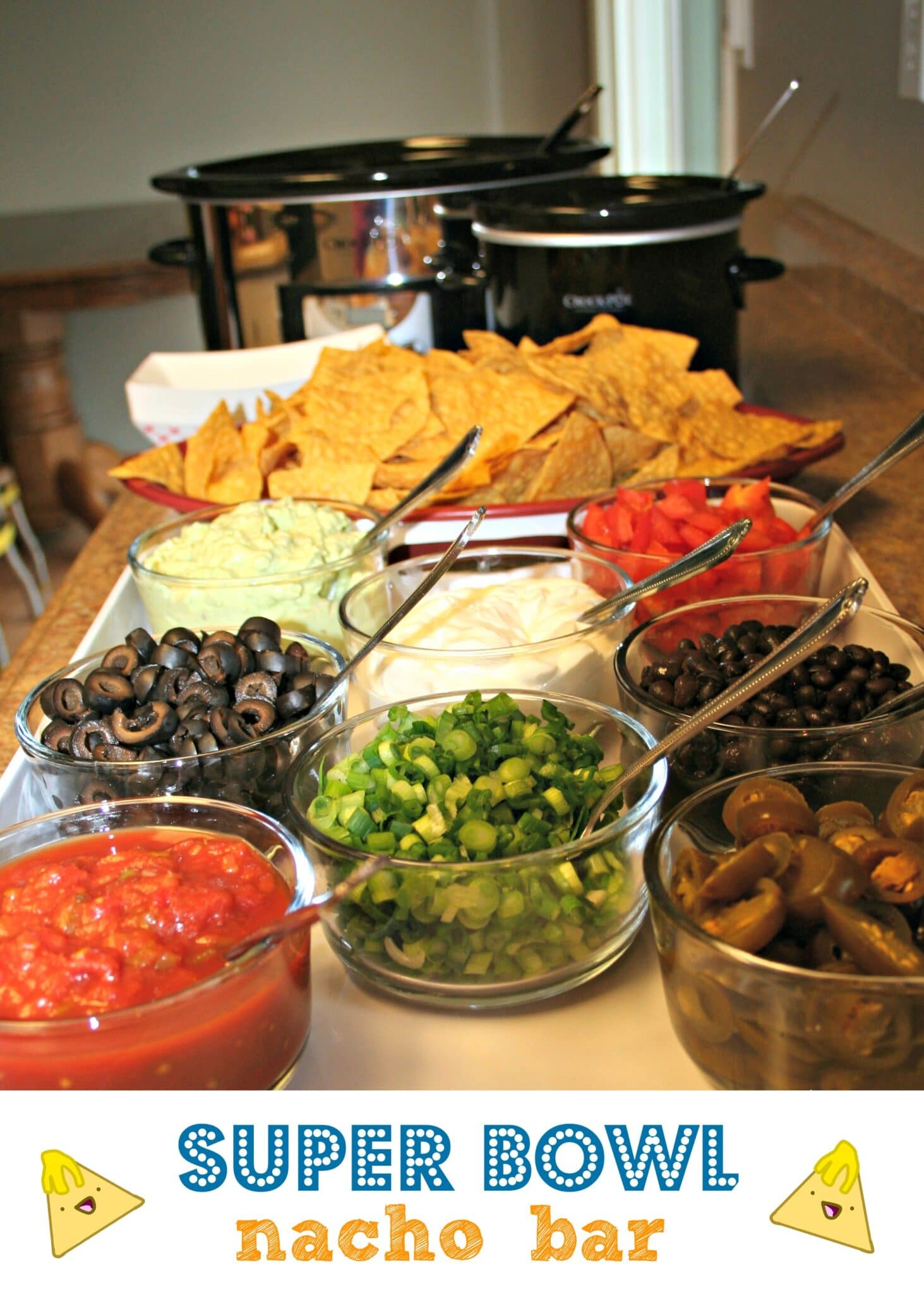 Toppings for nacho bar with 2 crock pots behind it.