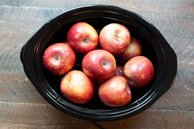 Whole apples in a slow cooker.
