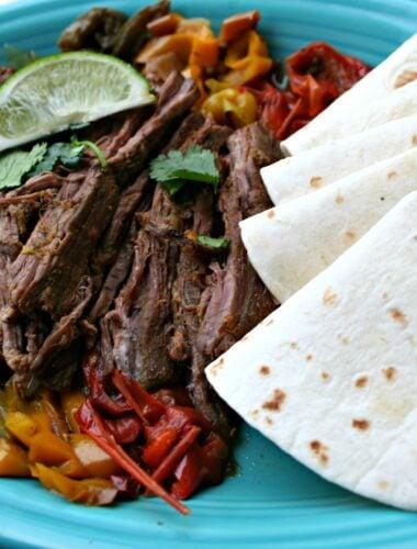 Steak Fajitas with tortillas on plate