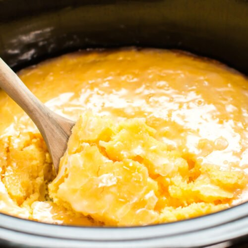 Lemon Spoon Cake with glaze in slow cooker with wooden spoon inside