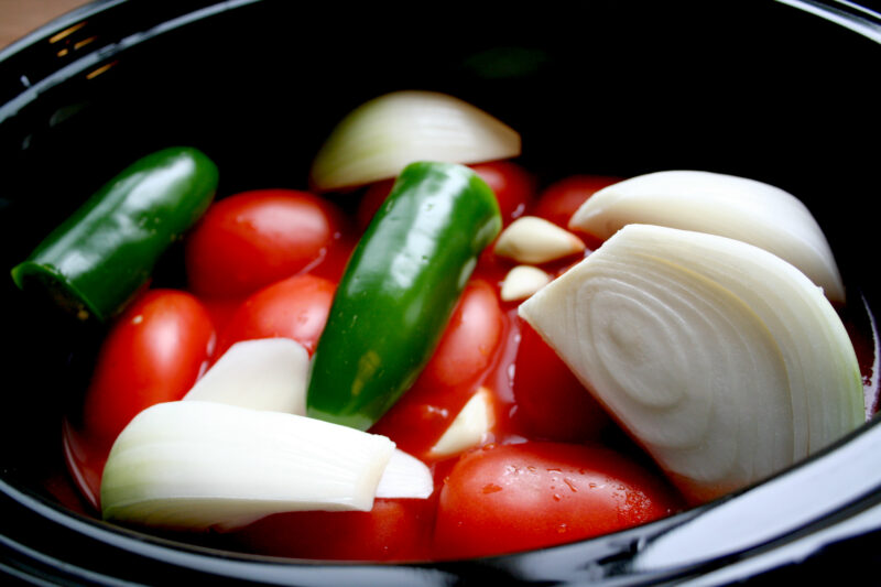 tomatoes, jalapenos, garlic and onion in a slow cooker
