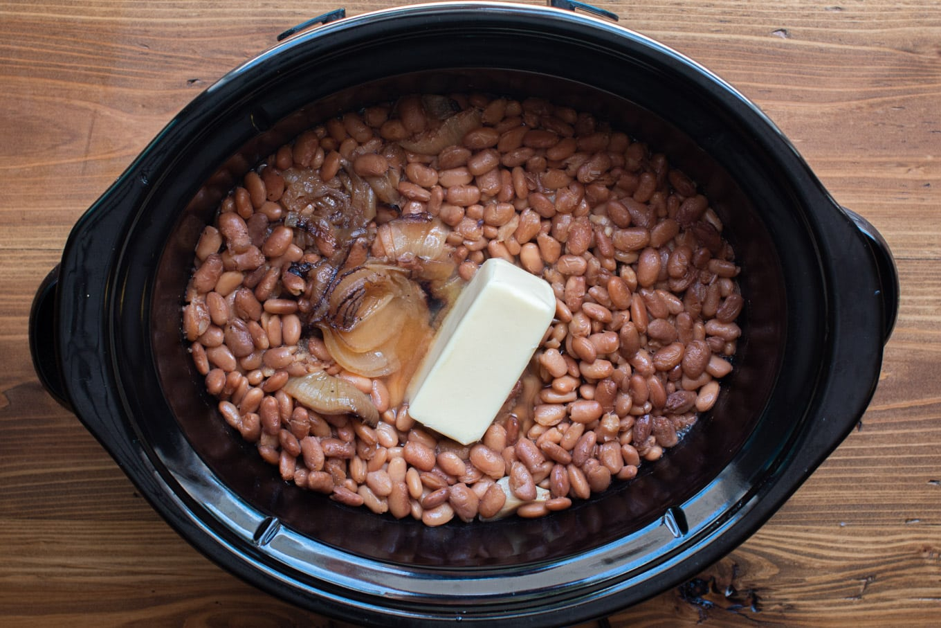 cooked pinto beans that have most of liquid drained off. Stick of butter on top.