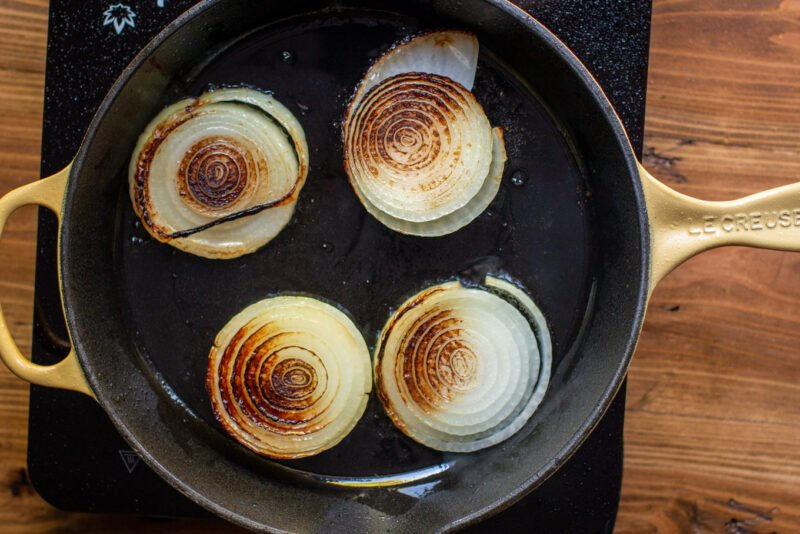 browned yellow onion slice in pan.