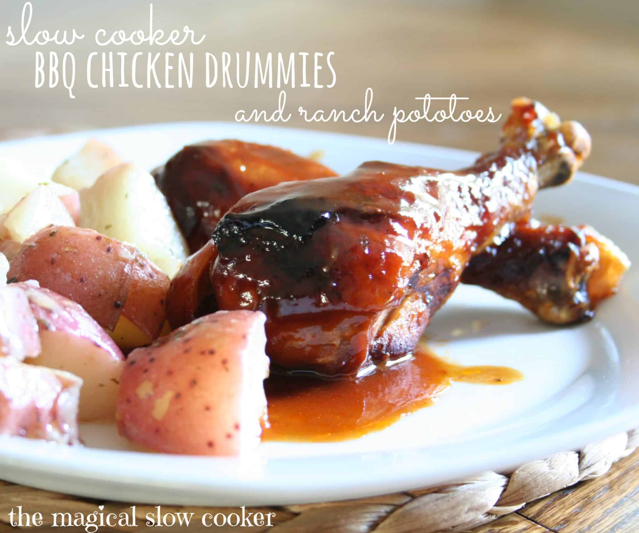 chicken drumsticks and potatoes on white plate