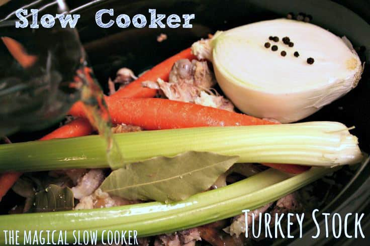 turkey bones, vegetables, water and peppercorns in slow cooker