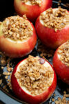 close up of baked apples in the slow cooker