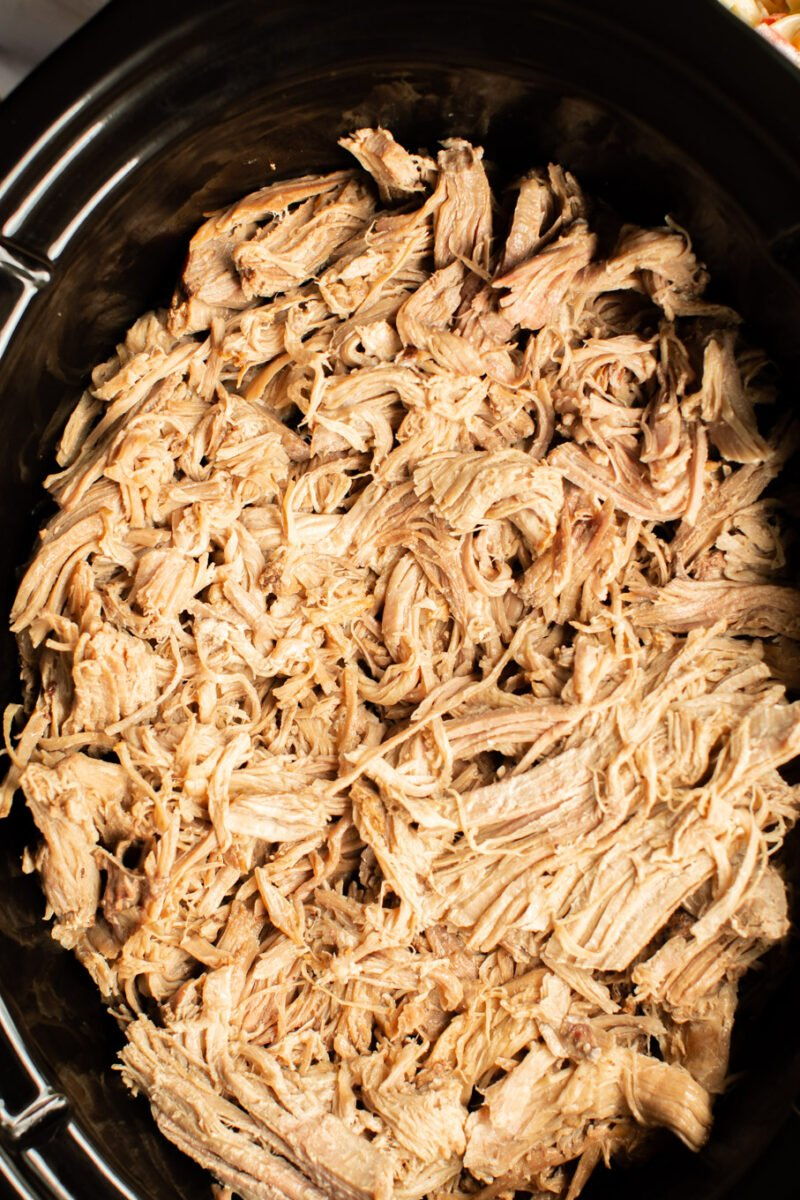 close up of shredded pork in the slow cooker.