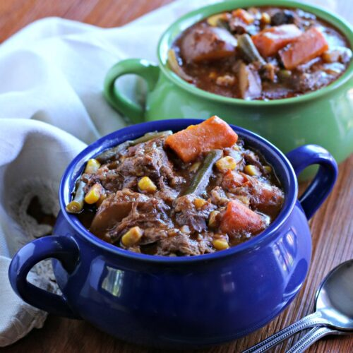 close up of beef stew in blue bowl