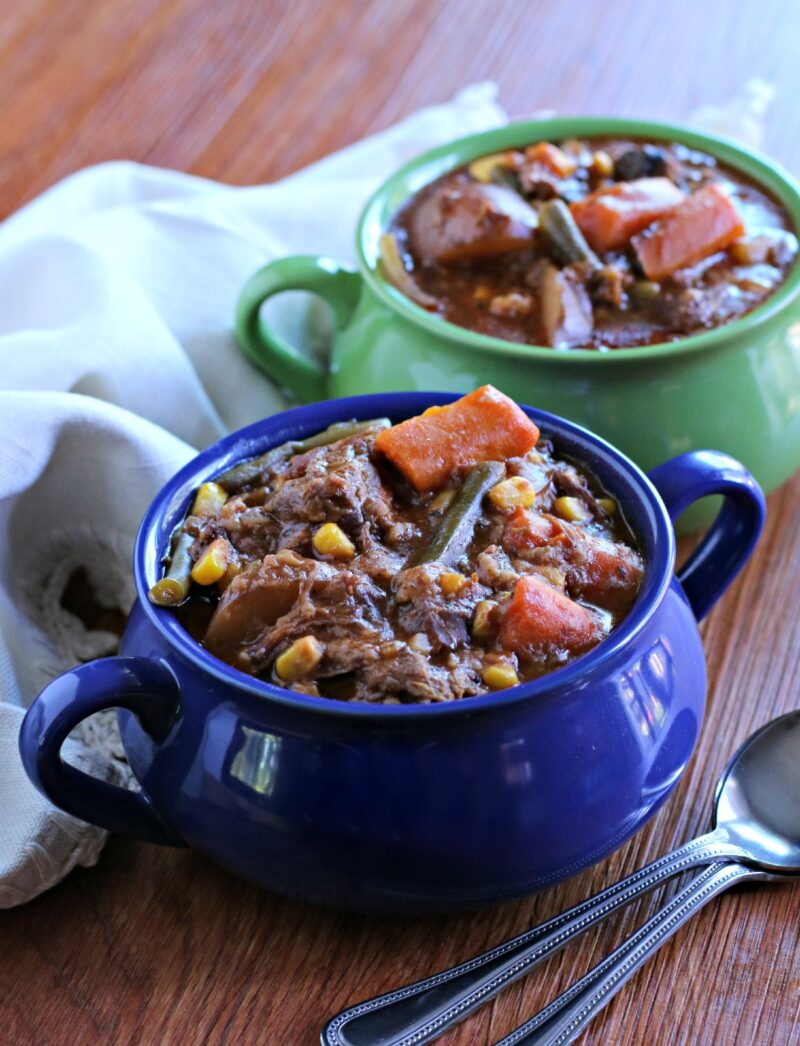 close up photo of 2 bowls of beef stew