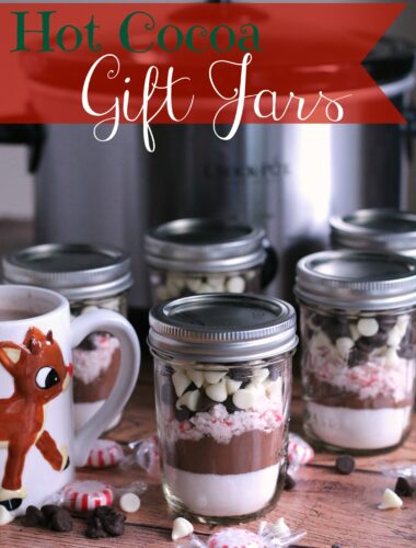 layered hot cocoa mix in glass jars
