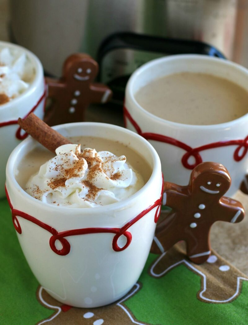 3 mugs of eggnog lattes, one with whipped cream