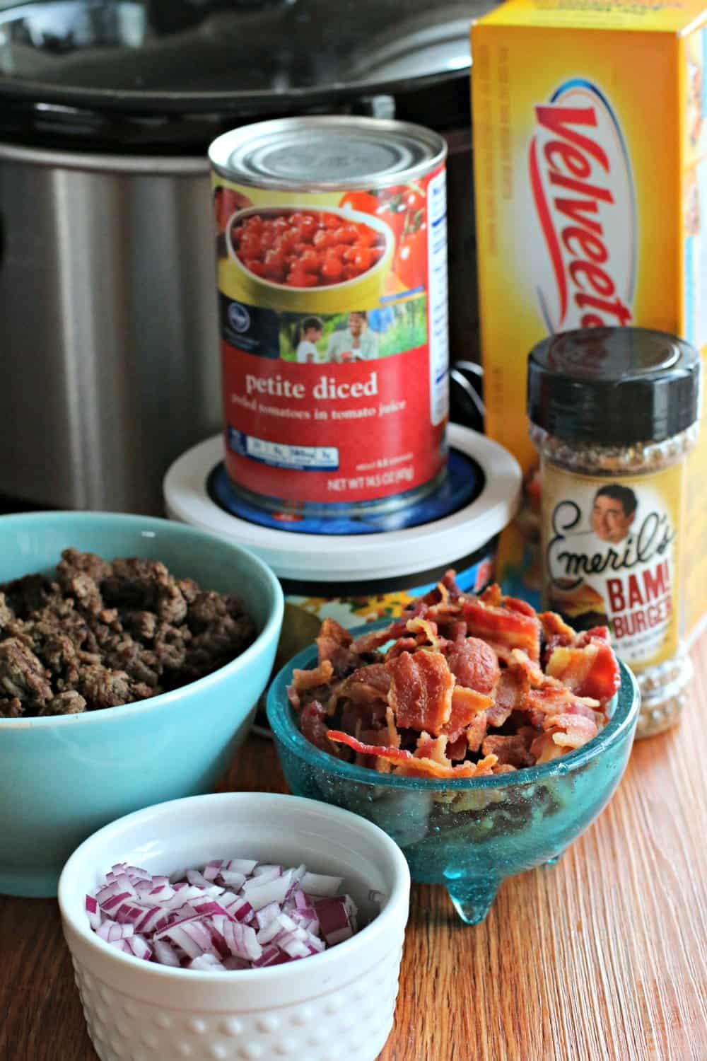 Slow Cooker Bacon Cheeseburger Dip ingredients in front of slow cooker