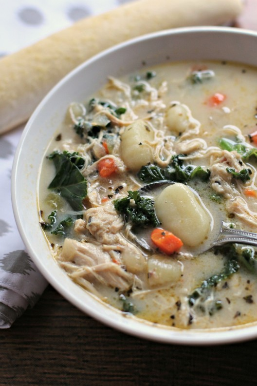 Chicken and Kale Gnocchi Soup in a dish with a spoon