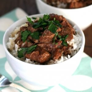beef tips and gravy of rice in white bowl