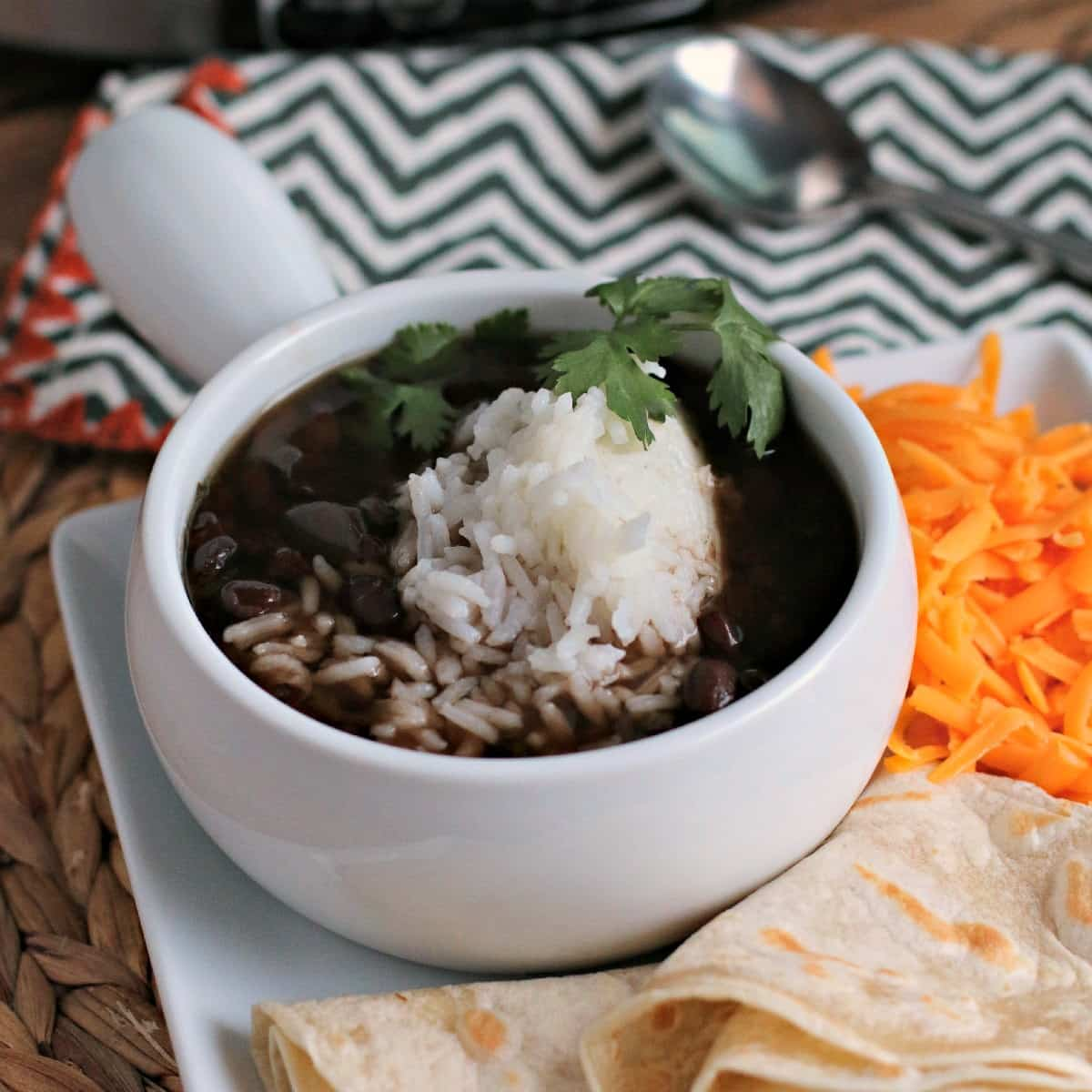 Slow Cooke Black Bean Soup in bowl over rice