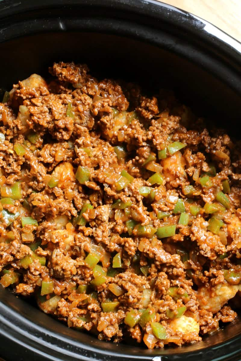 ground beef in slow cooker with taco seasoning, bell pepper and onion.