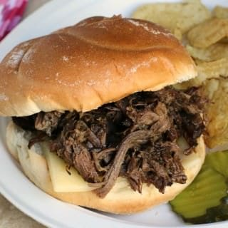 Slow Cooker Roasted Garlic Roast Beef Sandwiches