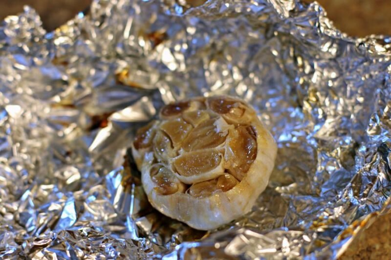 roasted garlic on foil, cooked