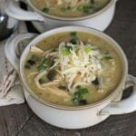 bowl of white chicken chili with cheese on top