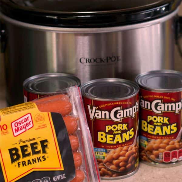 hot dogs and pork and beans in front of slow cooker