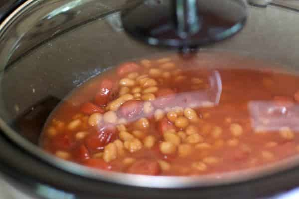 pork and beans and hot dogs with in slow cooker with lid on.