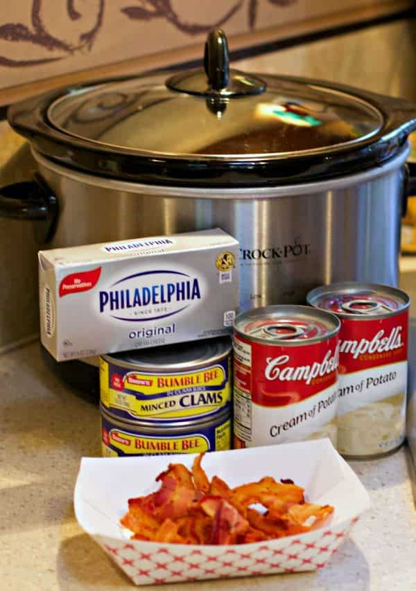 cream of potato soup, cream cheese, clams and bacon in front of slow cooker.