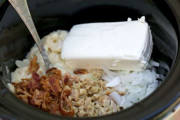 Cream of potatoes soup, cream cheese, clams, bacon, onion and cream cheese in slow cooker (not stirred).
