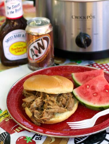 root beer pulled pork on bun with water melon on side