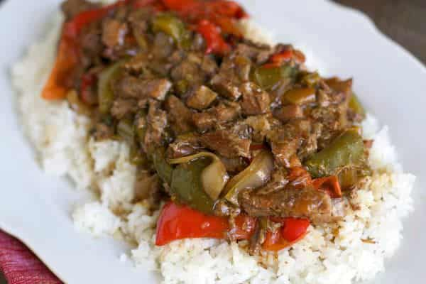 plated pepper steak on steamed rice