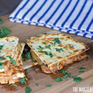 pieces of barbecue chicken quesadillas on cutting board