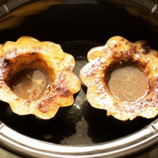 close up of 2 acorn squash cooked in slow cooker