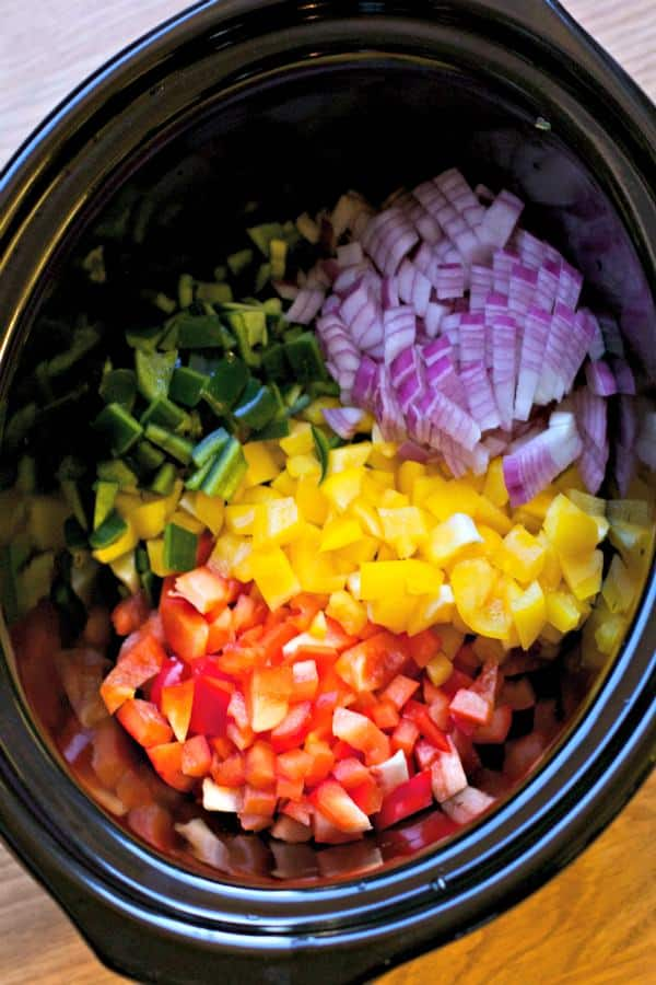 bell peppers, red onion and poblano peppers raw in slow cooker