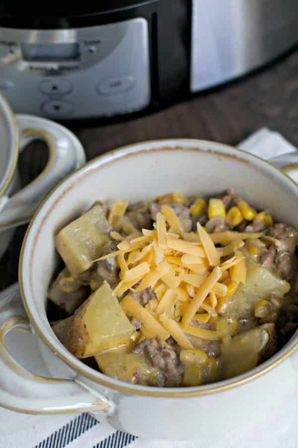 bowl of hamburger hash with cheddar cheese on top