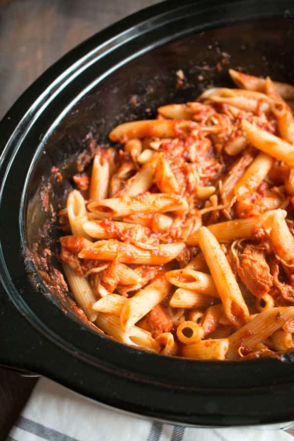 Pasta, marinara, chicken and penne pasta cooked in slow cooker.