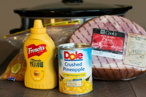 Ingredients for crockpot ham; ham, brown sugar, mustard and pineapple