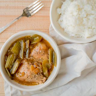 bowl of pepper chicken with rice on side.