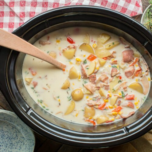 cooked corn chowder with red and white napkin on side