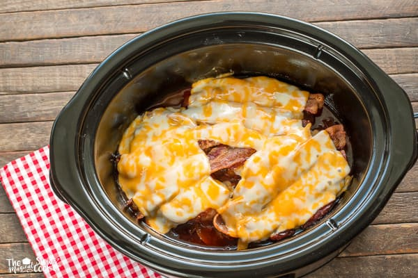 pork chops with cheese and bacon on top.