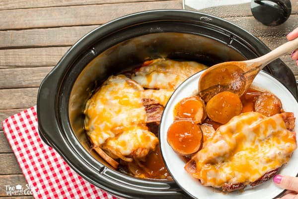 Potatoes and pork chops on plate, in slow cooker.