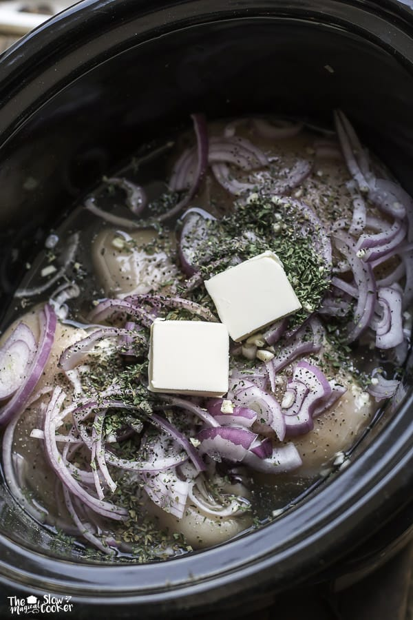 chicken breasts, butter, onions and butter in slow cooker