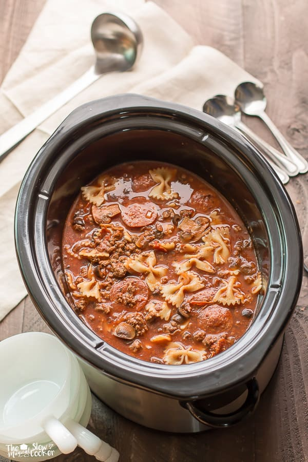Pizza soup in slow cooker with bowtie pasta