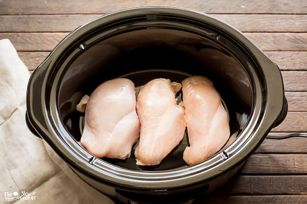 Three chicken breasts in slow cooker.