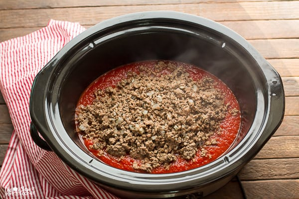 spaghetti sauce with ground beef on top.