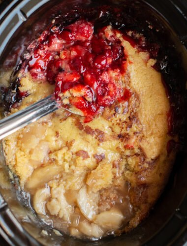 Cobbler with cherry on one half and apple on the other.