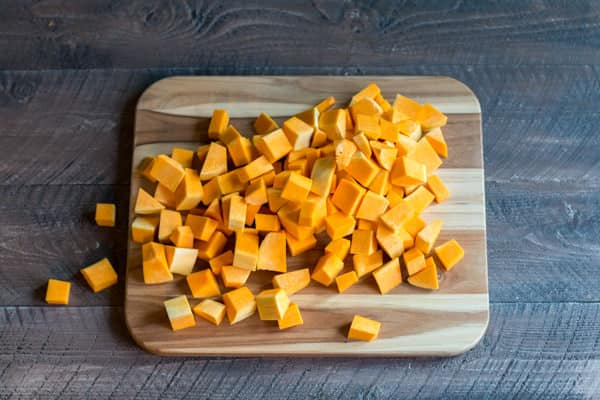 cubed butternut squash on a cutting board.