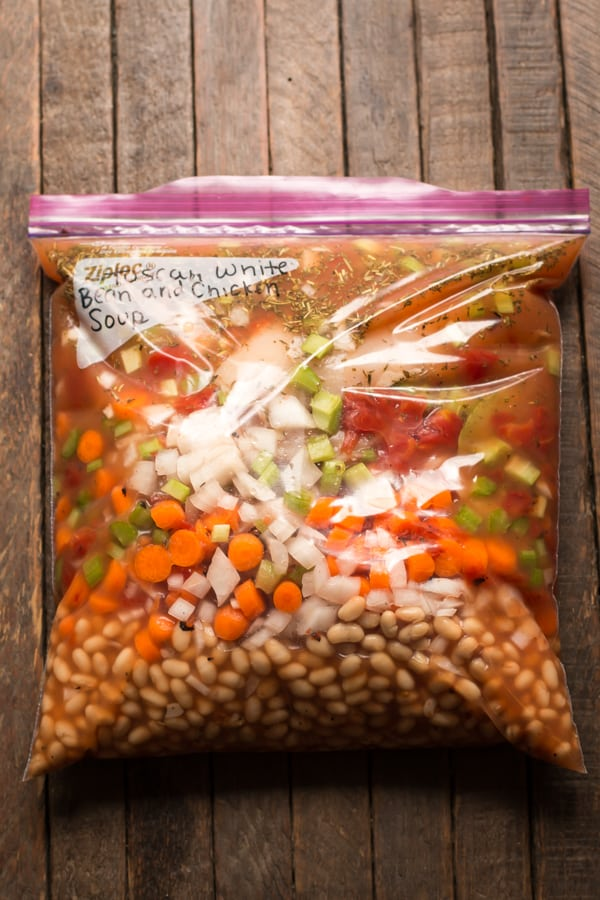 ziplock bag with beans, carrots, onion, celery, seasonings and broth in it.