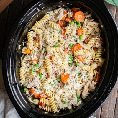 Garlic butter chicken pasta with carrots and peas in a slow cooker