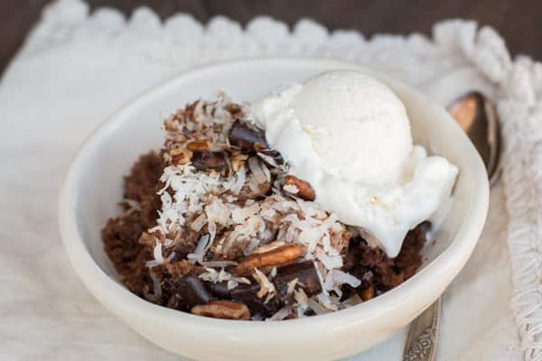 bowl of german chocolate spoon cake with ice cream on top.
