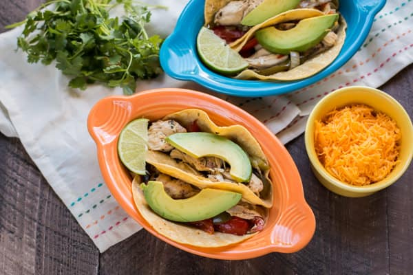 2 colorful bowls with tacos.
