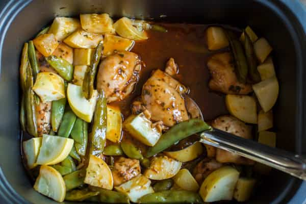 chicken, squash, and snow peas in a slow cooker.